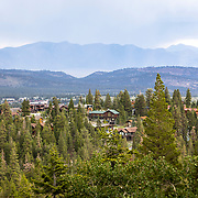 Homes are scattered throughout the trees in the town of Mammoth Lakes, providing for amazing views of the Eastern Sierra mountains and Inyo National Forest.