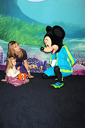"""AMANDA HOLDEN and her daughter LEXI photographed with Mickey Mouse at a VIP Opening night of Disney & Pixar's """"Finding Nemo on Ice"""" at The O2 Arena Grennwich London on 23rd October 2008."""