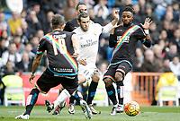 Real Madrid's Garet Bale (c) and Rayo Vallecano's Ze Castro (l) and Lass Bangoura during La Liga match. December 20,2015. (ALTERPHOTOS/Acero)