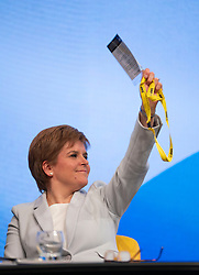 Edinburgh, Scotland, UK. 27 April, 2019. SNP ( Scottish National Party) Spring Conference takes place at the EICC ( Edinburgh International Conference Centre) in Edinburgh. Pictured; First Minister Nicola Sturgeon voting during a session on Day 1.