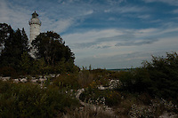 The Cana Island Lighthouse was built in 1869. It stands 89 feet tall.  Originally it was built of Cream City Brick, but was later clad in stell plate due to its extreme exposure to Lake Michigan. The light is located in Door County, Wisconsin.