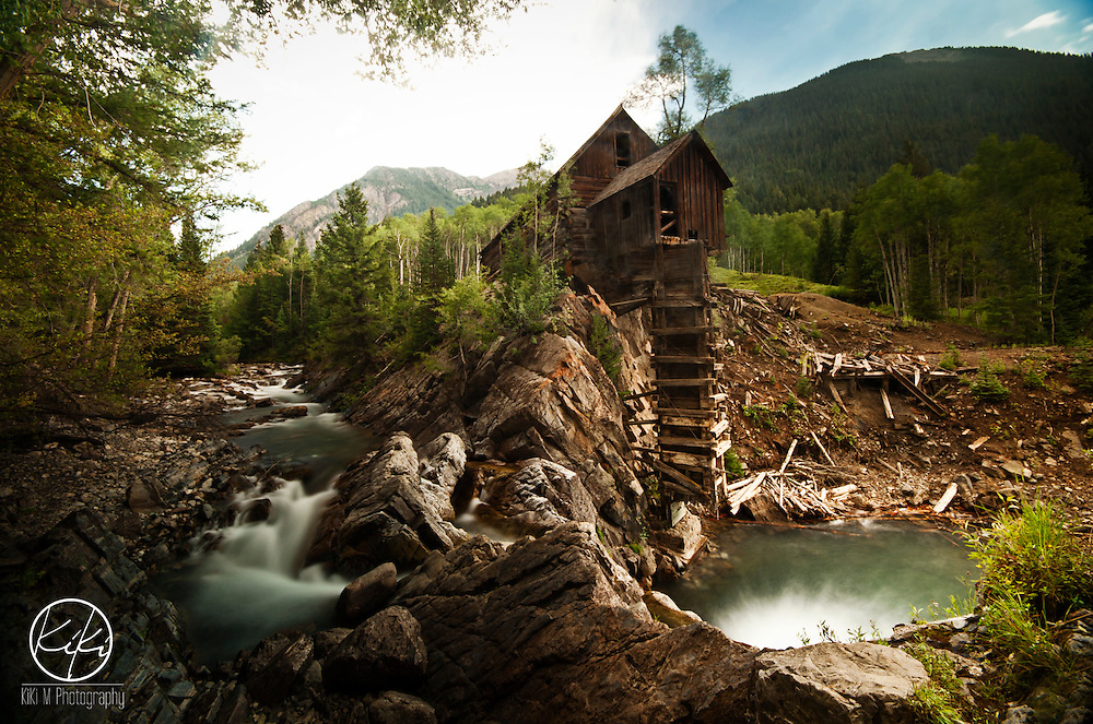 {Colorado : 2013} The Crystal Mill in Crystal Colorado is one hell of a hike. After you have passed a few mini waterfalls and maybe once or twice walked along a steep rock covered path and then come around several corners only to be greeted with another gorgeous mountain view, you arrive. There was a wedding shoot going on in one of the five buildings that the town had. Walk down a little further and you see this. The Old Crystal Mill. You could shoot here forever and never have a person in your shot. One of the best rewards at the end of a hike.