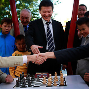 Kirsan Ilyumzhinov (centre), 44, president of the southern Russian republic Kalmykia, shakes hands with chess grandmasters Veselin Topalov (L) and Vladimir Kramnik (R)...Ilyumzhinov, who is also the president of the World Chess Federation, Fide, is hosting one of the world?s most important matches in history. ..The match beginning September 21 in Elista, the capital of Europe?s only Buddhist nation, will end a 13-year split in the game that has produced rival claims to the title. ..Topalov, a Bulgarian ranked first according to Fide, will play against Kramnik, who is the Classical Chess World Champion, a title established after Garry Kasparov led a breakaway from Fide in 1993. The two grandmasters, both aged 31, will face each other for the right to be undisputed world chess champion...A Buddhist millionaire businessman, Ilyumzhinov acquired his wealth in the economic free-for-all which followed the collapse of the Soviet Union. ..At the age of just over 30, he was elected president in 1993 after promising voters $100 each and a mobile phone for every shepherd. Soon after, he introduced presidential rule, concentrating power in his own hands. ..He denies persistent accusations of corruption, human rights abuses and the suppression of media freedom. When Larisa Yudina, editor of the republic's only opposition newspaper and one of his harshest critics, was murdered in 1998, he strenuously rejected allegations of involvement. ..Mr Ilyumzhinov has been president of the International Chess Federation (FIDE) since 1995 and has been enthusiastic about attracting international tournaments to Kalmykia. His extravagant Chess City has led to protests by its impoverished citizens..