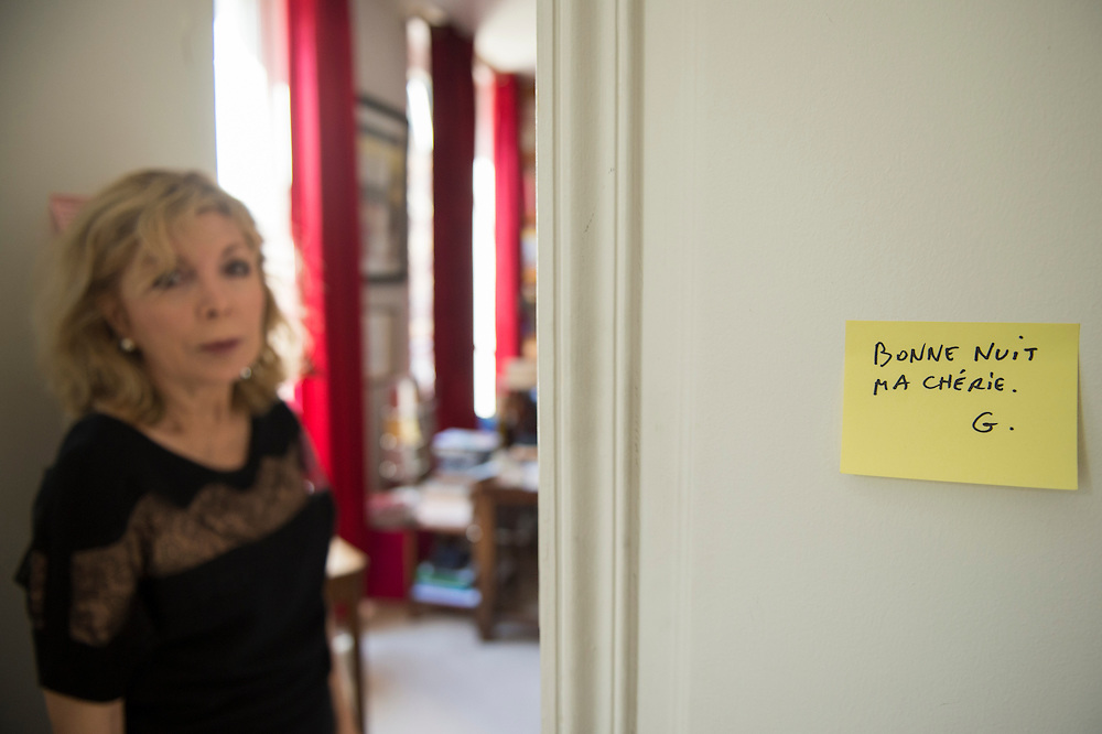 """March 6, 2015, Paris, France. Maryse Wolinski (1943, Algiers) standing beside a post-it note of her assassinated husband Georges Wolinski. Post-it notes still decorate the Paris' apartment where Georges and Maryse Wolinski used to live. French Cartoonist Georges Wolinski (1934 –2015) wrote daily post-it notes to his wife Maryse Wolinski. Two month after the death of Georges Wolinski, the apartment is full of souvenirs and notes, attesting a half-century-long love relation: """"Good night my darling. G."""" <br /> The cartoonist Georges Wolinski was 80 years old when he was murdered by the French jihadists Chérif en Saïd Kouachi, he was one of the 12 victims of the massacre in the Charlie Hebdo offices on January 7, 2015 in Paris. Charlie Hebdo published caricatures of Mohammed, considered blasphemous by some Muslims. During his life, Georges Wolinski defended freedom, secularism and humour and was one of the major political cartoonists in France. The couple was married and had lived for 47 years together. Photo: Steven Wassenaar."""