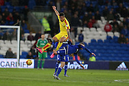 Jason Clarke -Harris of Rotherham Utd (l) collides with Stuart O'Keefe of Cardiff city as they jump for the ball. Skybet football league championship match, Cardiff city v Rotherham Utd at the Cardiff city stadium in Cardiff, South Wales on  Saturday 23rd January 2016.<br /> pic by  Andrew Orchard, Andrew Orchard sports photography.