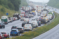© Licensed to London News Pictures 30/07/2021. Swanley, UK. Traffic near junction three for Swanley. It looks like getaway traffic for a second Friday in a row as miles of vehicles sit bumper to bumper queuing on the M25 in Kent from the Dartford Crossing to Junction 4 for Orpington. Photo credit:Grant Falvey/LNP