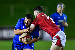 Lorenzo Michelini of Italy is tackled by Aneurin Owen of Wales <br /> <br /> Photographer Craig Thomas/Replay Images<br /> <br /> U20 Six Nations - Wales v Italy  - Friday 31st January 2020 - Stadiwm Zip World (Parc Eirias) - Colwyn Bay<br /> <br /> World Copyright © Replay Images . All rights reserved. info@replayimages.co.uk - http://replayimages.co.uk