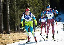 Klemen Bauer (SLO) and Dmitry Malyshko (RUS)  during Men 15 km Mass Start at day 4 of IBU Biathlon World Cup 2015/16 Pokljuka, on December 20, 2015 in Rudno polje, Pokljuka, Slovenia. Photo by Vid Ponikvar / Sportida