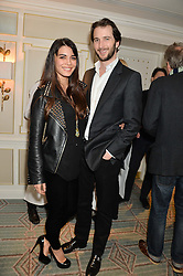 The HON.WILLIAM ASTOR and his wife LOHRALEE at the launch of Mrs Alice in Her Palace - a fashion retail website, held at Fortnum & Mason, Piccadilly, London on 27th March 2014.