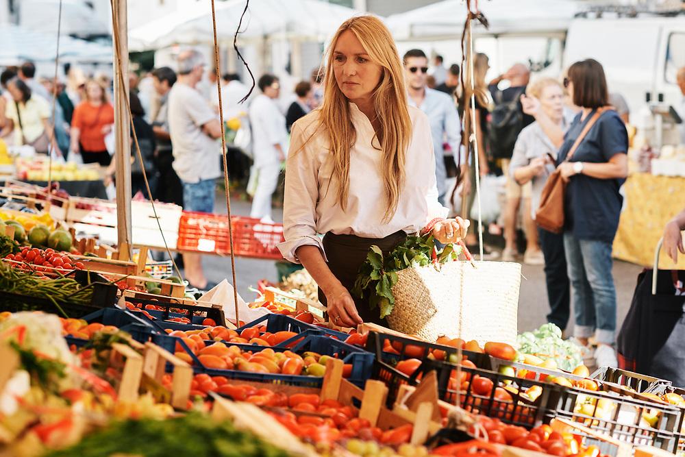 Collette Dinnigan in a fresh food market.  Ostuni, Italia. September 28, 2019.