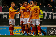 GOAL - Jake Hastie of Motherwell celebrates with his team mates following the opening goal during the Ladbrokes Scottish Premiership match between Motherwell and Heart of Midlothian at Fir Park, Motherwell, Scotland on 17 February 2019.