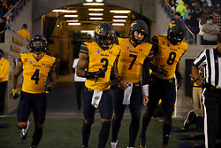 California game camptains Nikko Remigio (4), Elijah Hicks (3), Chase Garbers (7) and Kuony Deng (8) emerge from the tunnel before an NCAA college football game Nevada, Saturday, Sept. 4, 2021, in Berkeley, Calif. (AP Photo/D. Ross Cameron)