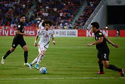June 13, 2017 - Bangkok, Bangkok, Thailand - Thailand's Tanaboon KESARAT (L) in action against OMAR ABDULRAHMAN (C) of the UAE and  Peerapat NOTECHAIYA (R) of the Thailand's during the FIFA World Cup 2018 qualifying soccer match between Thailand and the United Arab Emirates at the Rajamangala stadium in Bangkok, Thailand, 13 June 2017. (Credit Image: © Anusak Laowilas/NurPhoto via ZUMA Press)