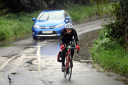 © Licensed to London News Pictures.16/09/2015<br /> Crockenhill,Kent as a cyclists battles the wet weather.<br /> Heavy rain in Kent is making driving on the roads dangerous for motorists and cyclists.<br /> <br /> (Byline:Grant Falvey/LNP)