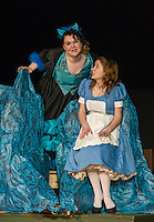 The Cheshire Cat (Hannah Smith) and Alice (Olivia Martinson) during Wednesday's dress rehearsal or Alice in Wonderland at the Winnisquam Regional High School auditorium.  (Karen Bobotas/for the Laconia Daily Sun)