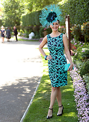 A female racegoer arrives during day four of Royal Ascot at Ascot Racecourse.
