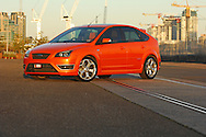2007 Focus XR5/ST Turbo hatch - Electric Orange.Docklands, Port Melbourne, Victoria .30th of August 2007.The XR5 name is a model used only in Australia, in the rest of the world this model is know as the Ford Focus ST.(C) Joel Strickland Photographics.Use information: This image is intended for Editorial use only (e.g. news or commentary, print or electronic). Any commercial or promotional use requires additional clearance.