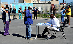 SOUTH AFRICA - Cape Town - 28 April 2020 - Screening of patients at a Covid-19 Community screening and testing site in Delft South. Two swabs are necessary for Covid-19 testing, one from your nose and one from your throat. Testing is critical for infected people to get the treatment they need and for health officials to accurately track the spread of the coronavirus. Picture:Brendan Magaar/African News Agency (ANA)
