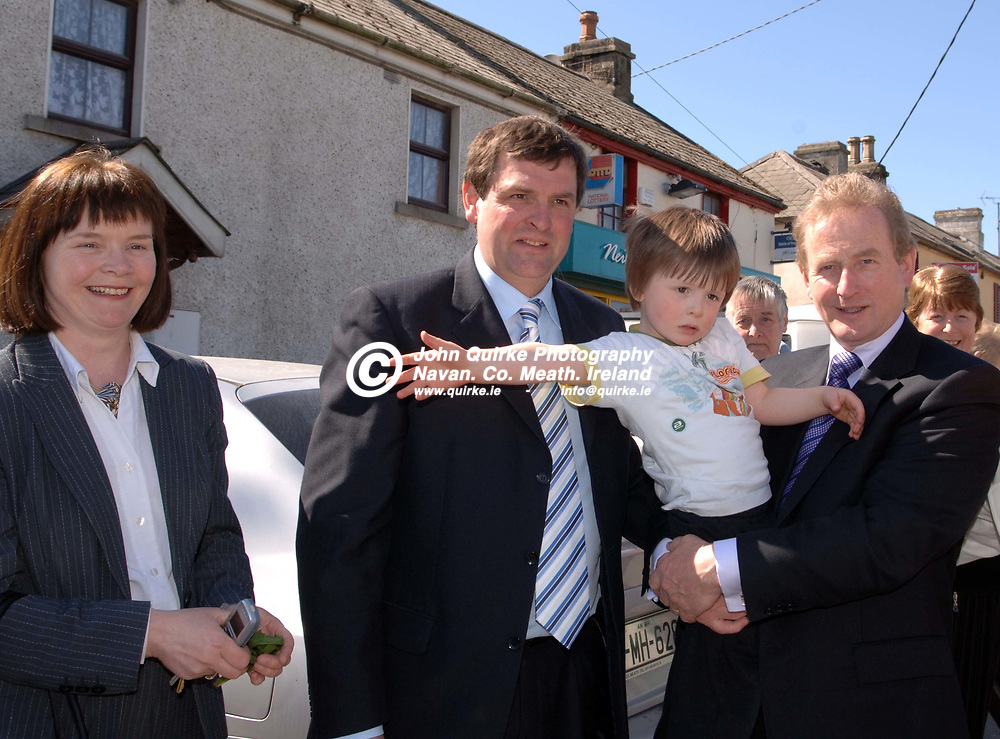 18-04-07. <br /> Enda Kenny, T.D. Leader of Fine Gael on a pre election visit to Nobber.<br /> L to R: Aileen McEntee, Shane McEntee, T.D., and Enda Kenny, T.D. holding Lorcan McEntee.<br /> Photo: John Quirke / www.quirke.ie<br /> ©John Quirke Photography, Unit 17, Blackcastle Shopping Cte.<br /> Navan. Co. Meath. 046-9079044 / 087-2579454.