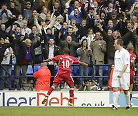 Photo: Aidan Ellis.<br /> Bolton Wanderers v Blackburn Rovers. The Barclays Premiership. 04/03/2007.<br /> Rovers Benni McArthy celebrates scoring the second penalty in front of the Rovers fans