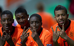Riechedly Bazoer, Elton Acolatse, Queensy Menig and ... of Netherlands celebrate after winning the UEFA European Under-17 Championship Semifinal match between Netherlands and Georgia on May 13, 2012 in SRC Stozice, Ljubljana, Slovenia. Netherlands defeated Georgia 2-0. (Photo by Vid Ponikvar / Sportida.com)
