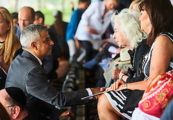 © Licensed to London News Pictures. 8/05/2016. London, UK. London's newly elected mayor, Sadiq Khan speaks to a woman at 'Yom Hashoah' the UK Jewish communities national holocaust remembrance commemoration at Barnet Copthall Stadium, north west London.<br /> Photo credit: Simon Jacobs/LNP