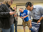07 MAY 2019 - AMES, IOWA: JULIÁN CASTRO autographs a yard sign during a campaign appearance at Collegiate United Methodist Church in Ames Tuesday. Castro is visiting Iowa to support his candidacy for the Democratic ticket of the US Presidency. Iowa traditionally hosts the the first selection event of the presidential election cycle. The Iowa Caucuses will be on Feb. 3, 2020.                           PHOTO BY JACK KURTZ