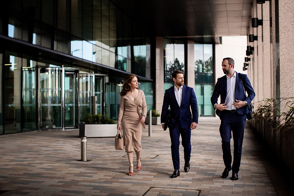 Corporate employees and colleagues walking outside their offices in the offshore banking and finance comemrcial centre of St Helier town in Jersey, CI