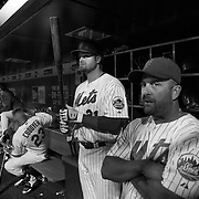 Lucas Duda, (center), New York Mets, preparing to bat in the dugout with hitting coach Kevin Long, (right), during the New York Mets Vs Atlanta Braves MLB regular season baseball game at Citi Field, Queens, New York. USA. 22nd September 2015. Photo Tim Clayton