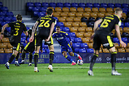 AFC Wimbledon midfielder Cheye Alexander (7) dribbling and surrounded by Bristol Rovers players during the EFL Sky Bet League 1 match between AFC Wimbledon and Bristol Rovers at Plough Lane, London, United Kingdom on 5 December 2020.
