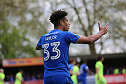 AFC Wimbledon striker Lyle Taylor (33) appealing for foul during the EFL Sky Bet League 1 match between AFC Wimbledon and Peterborough United at the Cherry Red Records Stadium, Kingston, England on 17 April 2017. Photo by Matthew Redman.