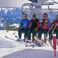 Skiers get off lift at the exclusive, members-only Yellowstone Club.