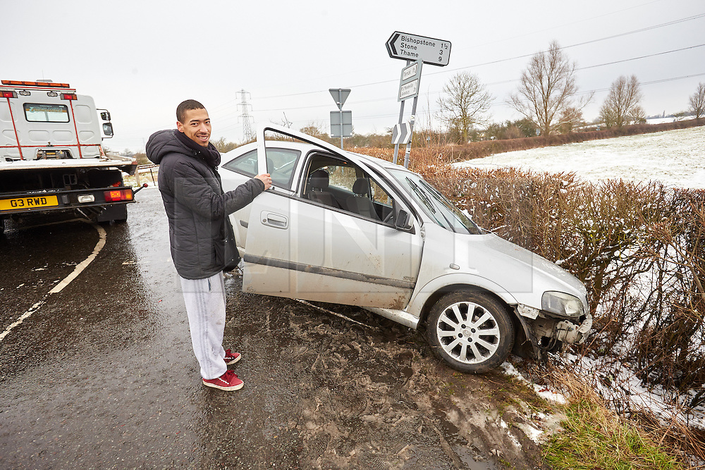 © Licensed to London News Pictures.  03/02/2015. AYLESBURY, UK. Theo Call (pictured), 21, helps recover his crashed car. Theo, who has been driving for a just over a year, skidded going round a corner despite only going 5 miles an hour and ended up stuck in a ditch. <br /> <br /> Thames Valley Police have closed Bishopstone Road near Aylesbury after deeming it too dangerous following a series of accidents and stuck vehicles. Overnight over an inch of snow fell and is causing travel chaos across the region. Photo credit: Cliff Hide/LNP