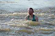 """Putney/Mortlake, GREATER LONDON. United Kingdom. 2017 Women's and Men's University Boat Races, held over, The Championship Course, Putney to Mortlake on the River Thames. CUWBC Cox emerges after being """"thrown in"""" Sunday  02/04/2017, <br /> <br /> [Mandatory Credit; Intersport Images]"""