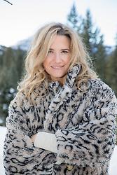 beautiful woman in an imitation fur outdoors