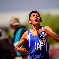050915  Adron Gardner<br /> <br /> Laguna Acoma Hawk Justin Chino crosses the finish line in third place for the boys 3A 1600m race during the New Mexico state track meet in Albuquerque Saturday.  Chino finished with a time of 4:53.58.