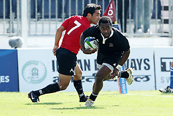 Tomasi Cama goes over for a try during the XIX Commonwealth Games 7s rugby match between New Zealand and Canada held at The Delhi University in New Delhi, India on the  10 October 2010..Photo by:  Ron Gaunt/photosport.co.nz