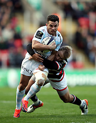 Racing 92's Brice Dulin is tackled by Leicester Tigers Mathew Tait during the European Champions Cup, Pool One, match at Welford Road, Leicester.
