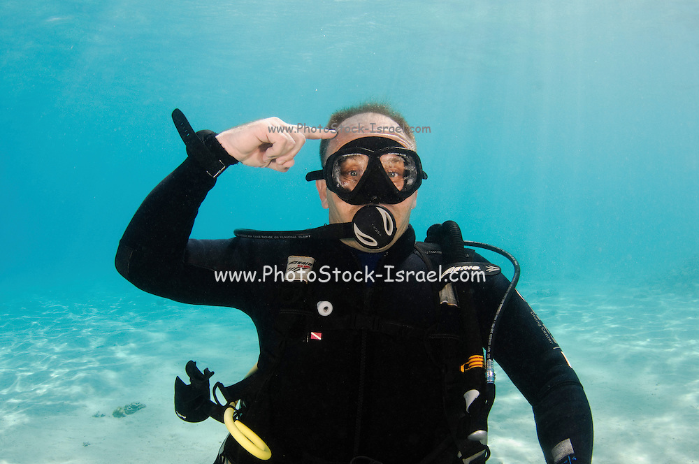 Underwater Hand signs scuba diver demonstrates the sign language for divers. Think