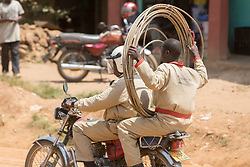 Carrying Cable On Motobike
