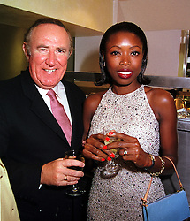 MISS LAUREN BURGESS and MR ANDREW NEIL the newspaper editor, at a party in London on 4th October 2000.OHP 85