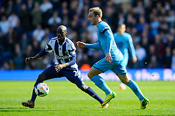 Christian Eriksen (DEN) of Tottenham Hotspur is challenged by Youssuf Mulumbu (COD) of West Brom - Photo mandatory by-line: Rogan Thomson/JMP - 07966 386802 - 12/04/2014 - SPORT - FOOTBALL - The Hawthorns Stadium - West Bromwich Albion v Tottenham Hotspur - Barclays Premier League.