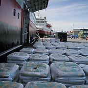 Goods waiting to be loaded at the portelone of the passenger ship Kong Harald. Three weeks aboard the Kong Harald. Hurtigruten, the Coastal Express. Bergen.