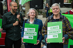 London, UK. 1st May, 2019. Green Party activists, including Baroness Jenny Jones (c) join climate protesters attending a Declare A Climate Emergency Now demonstration in Parliament Square organised to coincide with a motion in the House of Commons to declare an environment and climate emergency tabled by Leader of the Opposition Jeremy Corbyn. The motion, which does not legally compel the Government to act, was passed without a vote.