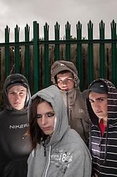 Young people wearing hoodies UK. Posed