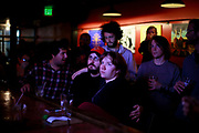 110816 - Bloomington, Indiana, USA: Patrons at the Bishop bar react while watching election results on TV that appear to show Hillary Clinton getting beaten by Donald Trump during the 2016 presidential election. (Jeremy Hogan/Polaris)