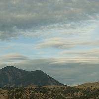 High altitude lenticular clouds presage a fall storm over Bridger Mountains, near   Bozeman Montana.