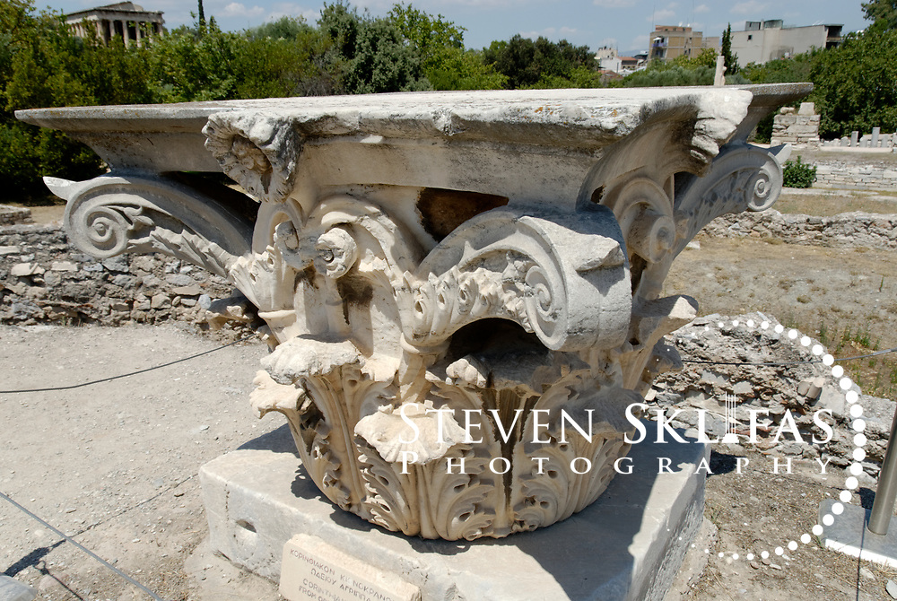 Ancient Agora. Athens. Greece. View of a Corinthian capital from the Odeion of Agrippa in the central area of the Agora. The Odeion, built by Marcus Vipsanius Agrippa son in law of Emperor Augustus in 15 BC, was a roofed building, with a two-storeyed portico, a semicircular orchestra and could accommodate 1000 spectators. It was destroyed by the Herulians in 267 AD.  In 400 AD, the Palatial Palace was built over the remains of the Odeion of Agrippa, the Palace was a large complex consisting of courtyards, gardens, baths and numerous rooms.