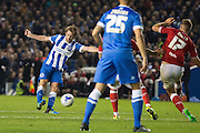Brighton central midfielder, Dale Stephens (6) shoots at goal during the Sky Bet Championship match between Brighton and Hove Albion and Bristol City at the American Express Community Stadium, Brighton and Hove, England on 20 October 2015. Photo by Phil Duncan.