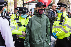 An activist from Palestine Action is detained by Metropolitan Police officers for a search during a protest outside the UK headquarters of Elbit Systems, an Israel-based company developing technologies used for military applications including drones, precision guidance, surveillance and intruder-detection systems, on 11th May 2021 in London, United Kingdom. The activists were protesting against the company's presence in the UK and in solidarity with the Palestinian people following attempts at forced evictions of Palestinian families in the Sheikh Jarrah neighbourhood of East Jerusalem, the deployment of Israeli forces against worshippers at the Al-Aqsa mosque during Ramadan and air strikes on Gaza which have killed several children.